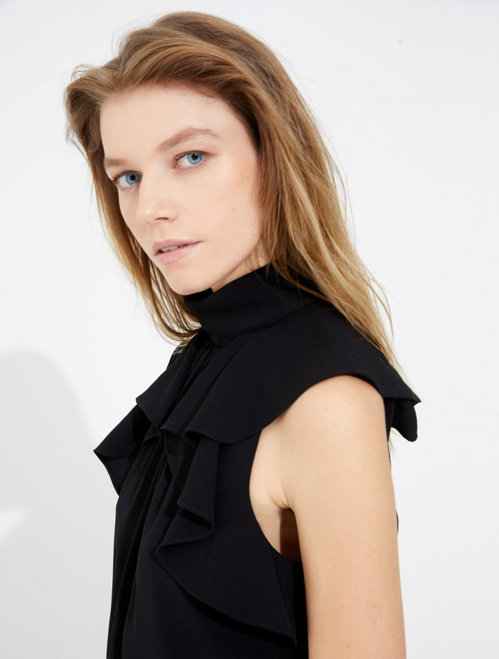 MOCK NECK TOP WITH FLOUNCE DETAIL